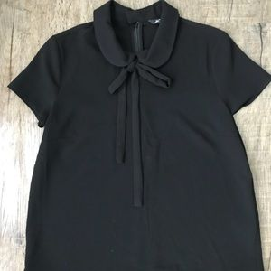 BLOUSE. BLACK
